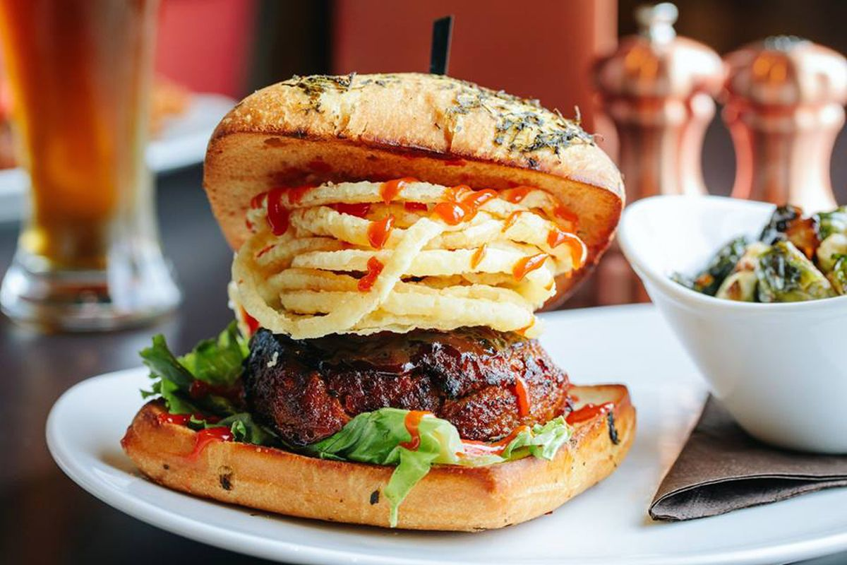 110 Grill's meatloaf burger topped with onion strings