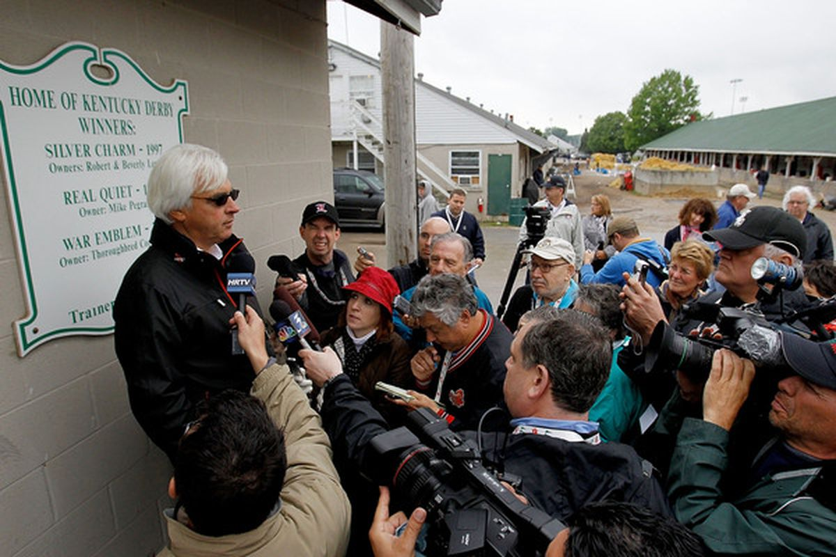 LOUISVILLE, KY - APRIL 26: Bob Baffert, trainer of Kentucky Derby favorite Lookin at Lucky fields questions from the media after morning exercise at Churchill Downs on April 26, 2010 in Louisville, Kentucky.  (Photo by Matthew Stockman/Getty Images)