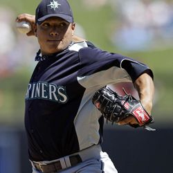 Seattle Mariners starting pitcher Erasmo Ramirez throws to the Colorado Rockies during the third inning of a spring training baseball game on Tuesday, April 3, 2012 in Scottsdale, Ariz.