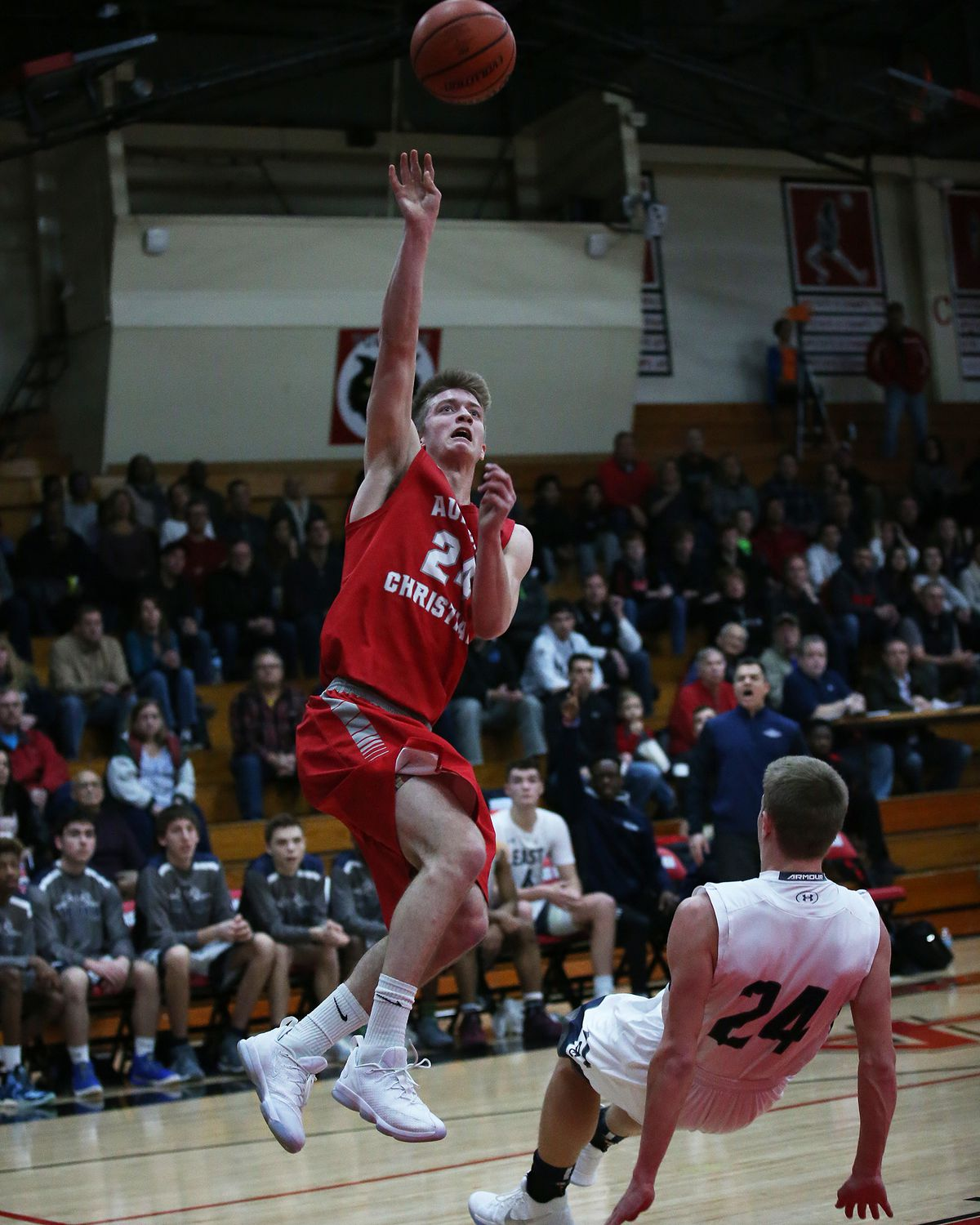 Aurora Christian's Will Wolfe (24) gets a shot to fall as he fouled in the first half against Oswego East.