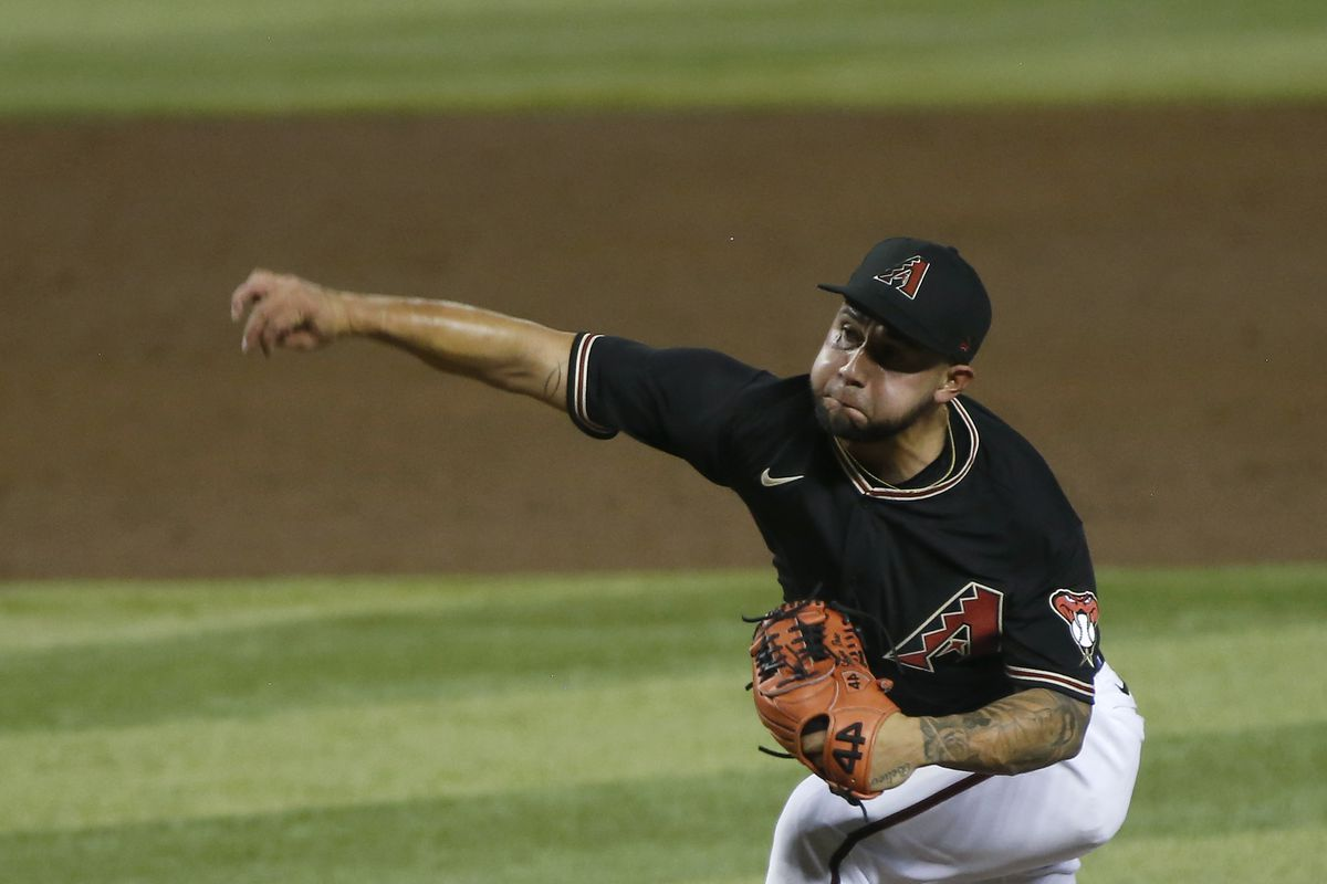Silvino Bracho of the Arizona Diamondbacks, wearing the black alternative jerseys with the A logo on the left side of the chest, throws a pitch at Chase Field
