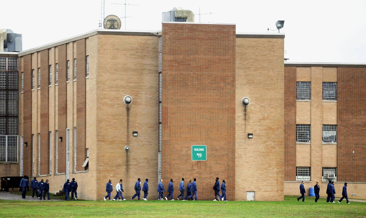 Inmates exit a building at the Vienna Correctional Center, a federal prison in Vienna, Ill, in 2011.