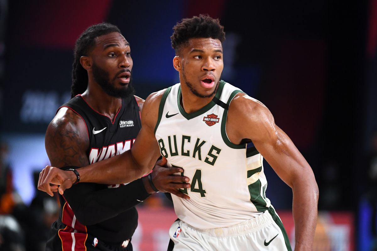Giannis Antetokounmpo of the Milwaukee Bucks and Jae Crowder of the Miami Heat fight for position during Game Four of the Eastern Conference Semifinals of the NBA Playoffs on September 6, 2020 at The AdventHealth Arena at ESPN Wide World Of Sports Complex in Orlando, Florida.