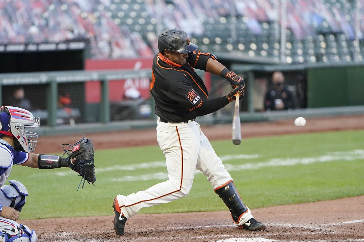 Donovan Solano #7 of the San Francisco Giants hits a two-run rbi single against the Texas Rangers in the bottom of the third inning at Oracle Park on August 01, 2020 in San Francisco, California.
