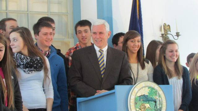 Gov. Mike Pence talks with high school students at Indiana's old statehouse after speaking about education in Indiana's first capital of Corydon. (Scott Elliott)