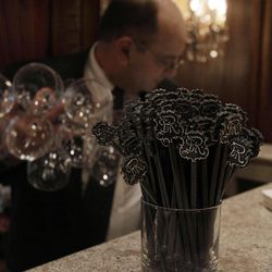 A waiter sets up a bar in New York's St. Regis Hotel, Wednesday, March 14, 2012. A century after the Titanic sank, the legacy of the ship's wealthiest and most famous passenger, John Jacob Astor, quietly lives on at the luxury hotel he built in New York City.