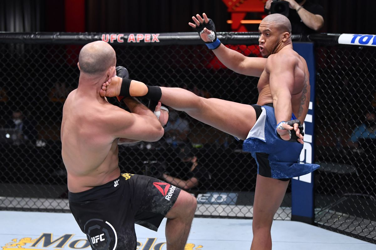 Ciryl Gane of France kicks Junior Dos Santos of Brazil in their heavyweight bout during the UFC 256 event at UFC APEX on December 12, 2020 in Las Vegas, Nevada.