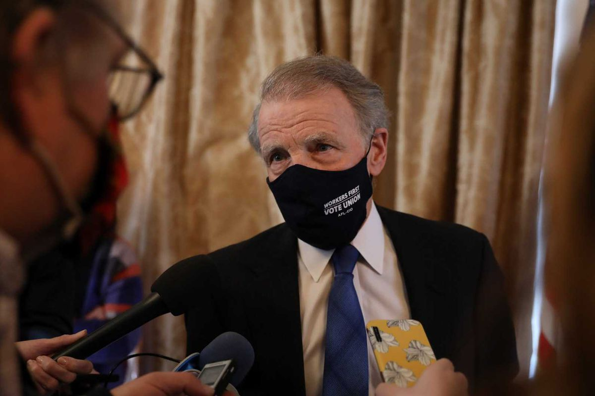Former Illinois House Speaker Mike Madigan talks to reporters in February.