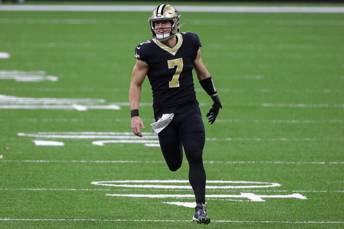 New Orleans Saints quarterback Taysom Hill celebrates after a touchdown pass but the play was called back due to a penalty during the second half against the Atlanta Falcons at the Mercedes-Benz Superdome.