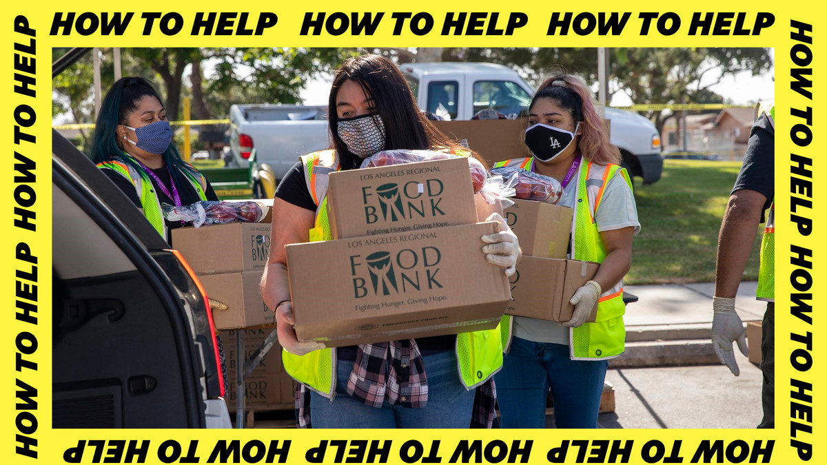 Los Angeles Regional Food Bank workers load food into a car.