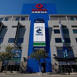 A cyclist rides past Rogers Arena, the home of the Vancouver Canucks NHL hockey team, in Vancouver, British Columbia, on Sunday Sept. 16, 2012. The NHL locked out its players at midnight Saturday, the fourth shutdown for the NHL since 1992, including a year-long dispute that forced the cancellation of the entire 2004-05 season.