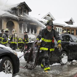 Chicago Fire Department firefighters battle a blaze in a one-and-a-half-story house in the 2900 block of North Luna Avenue in the Belmont Cragin neighborhood, Thursday afternoon, Jan. 31, 2019. No one was injured in the fire. | Ashlee Rezin/Sun-Times