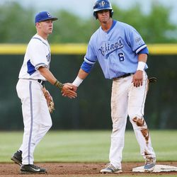 Pleasant Grove's Jade Smoot, right, gives Bingham's Riley Akers five after Akers got him out at second base as Bingham and Pleasant Grove play Wednesday, May 21, 2014 in a 5A one-loss bracket game at Kearns.