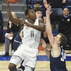 Air Force's Ameka Akaya shoots over Utah State's Justin Bean during the first half of an NCAA college basketball game Thursday, Dec. 31, 2020, at Air Force Academy, Colo.