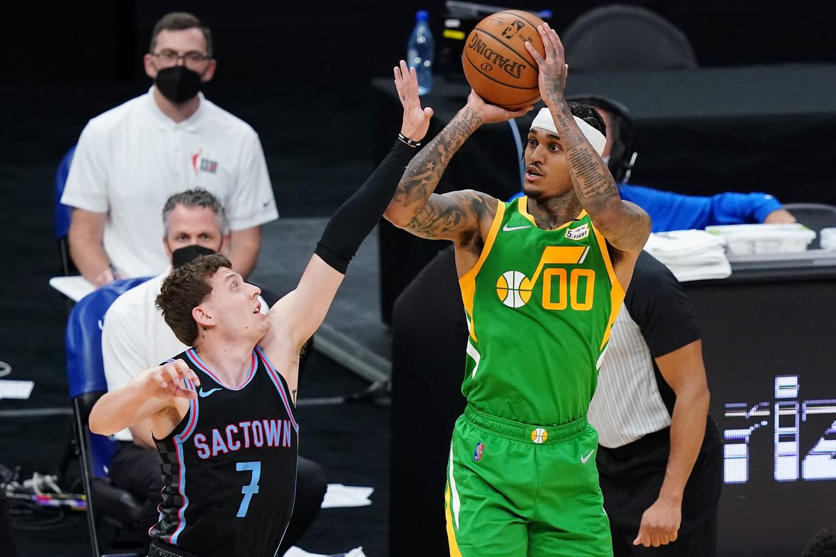 Jordan Clarkson #00 of the Utah Jazz shoots over Kyle Guy #7 of the Sacramento Kings during the fourth quarter at Golden 1 Center on May 16, 2021 in Sacramento, California.