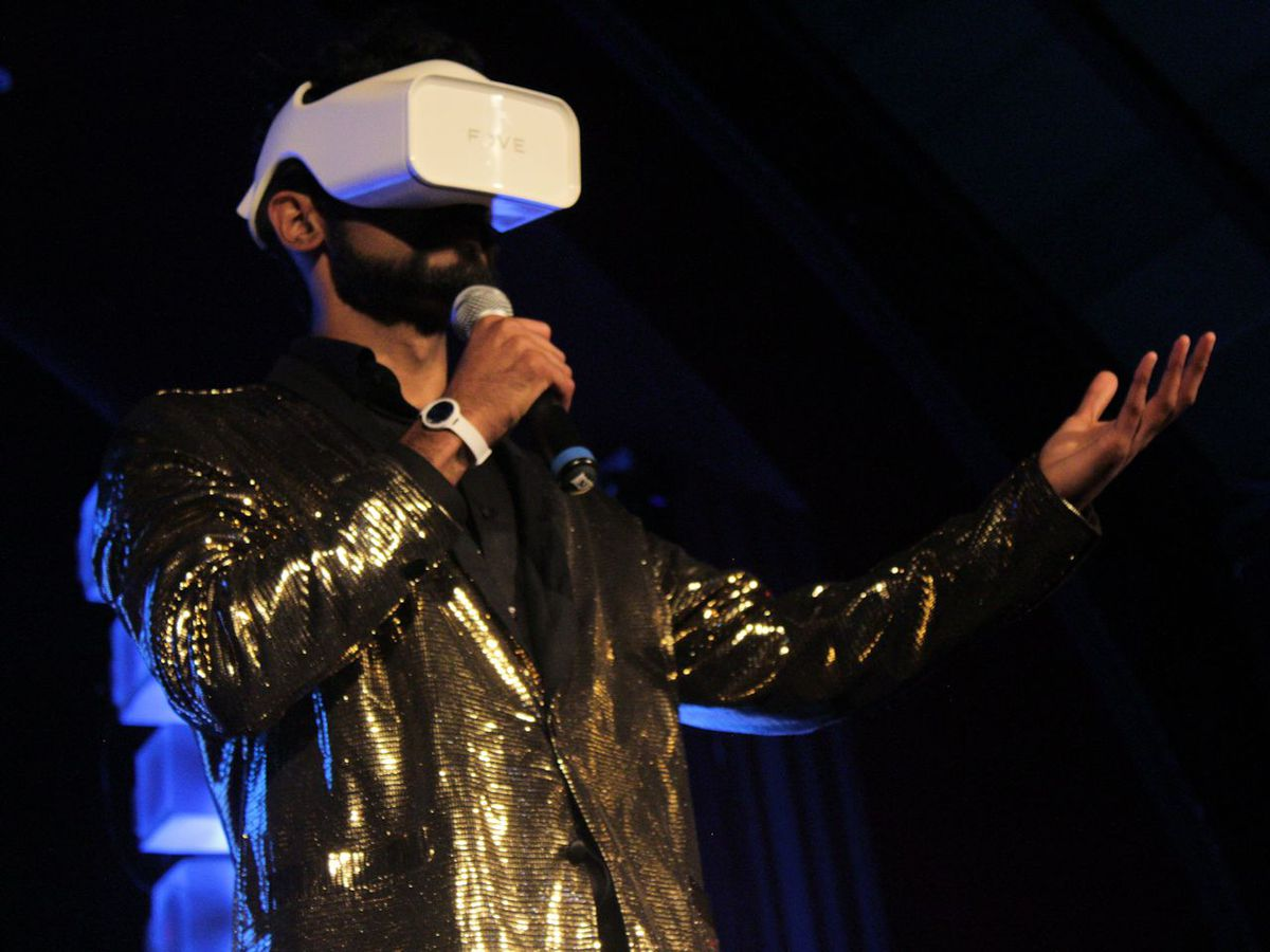 The emcee finished the night with a VR set strapped to his face.