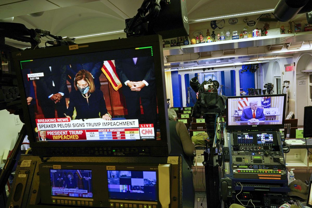President Donald Trump is seen speaking on a television monitor in an empty press briefing room at the White House in Washington.