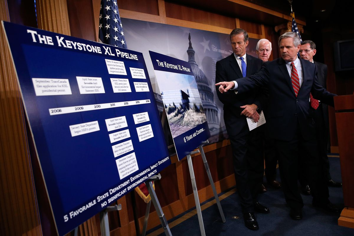 Sen. John Hoeven (2nd R) points to a chart while speaking at a press conference with (L-R) Sen. John Thune (R-SD), Sen. John Cornyn (R-TX) and Sen. John Barrasso (R-WY) at the U.S. Capitol September 18, 2014 in Washington, DC.