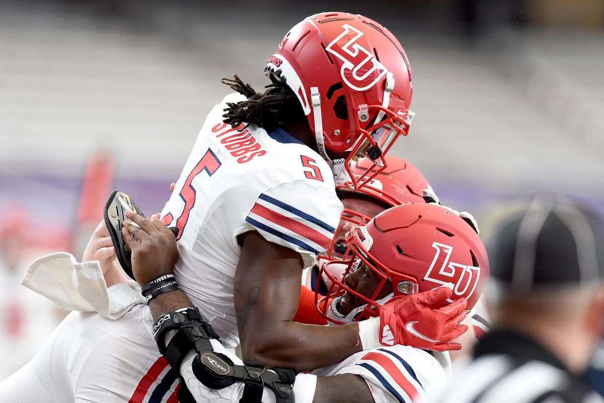 Liberty Flames wide receiver DJ Stubbs is lifted after his touchdown in the second half during a game against Syracuse on Saturday, Oct. 17, 2020, at the Carrier Dome in Syracuse, N.Y.