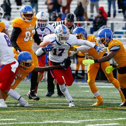 Lakes' Jack Lochner (17) tries to run past Simeon's defense.
