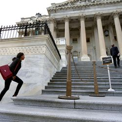 Rep. Mia Love, R-Utah, rushes up the stairs of the U.S. Capitol for a vote in Washington, D.C., on Tuesday, Dec. 8, 2015.