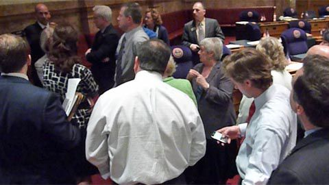Colorado lawmakers sealed the 2011-12 budget deal during this midday huddle on the Senate floor.