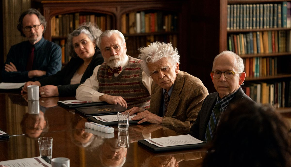 """A panel of the """"craggy white establishment"""" in The Chair, including Bob Balaban and four other older, grouchy-looking professors"""