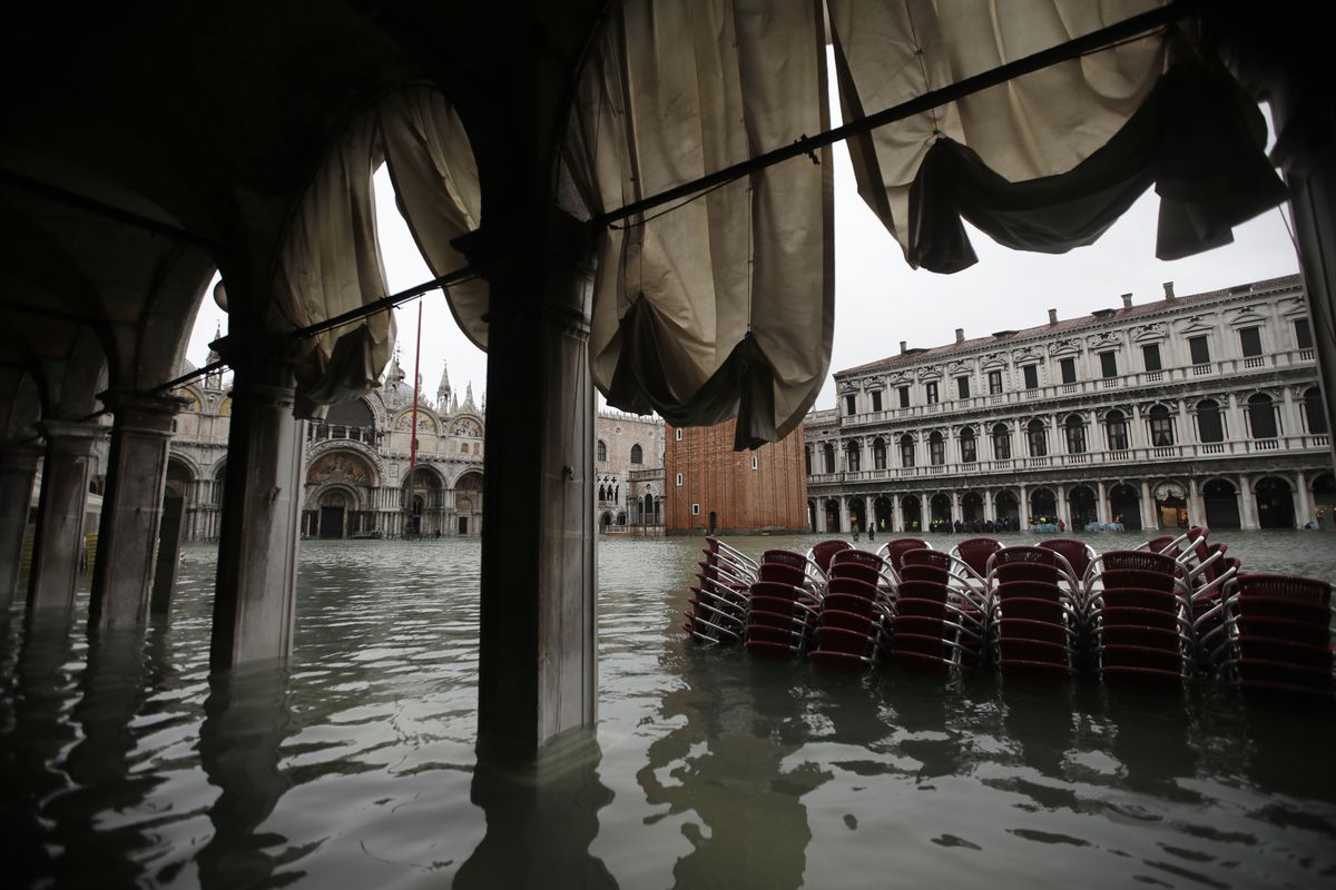 Chairs are piled up in the water in a flooded St. Mark's Square in Venice, Italy. The high-water mark hit 74 inches late Tuesday, meaning more than 85 percent of the city was flooded.