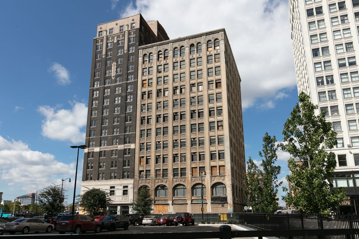 The exterior of the Park Avenue building in Detroit.  The facade is light brown with arched windows on the lower level.