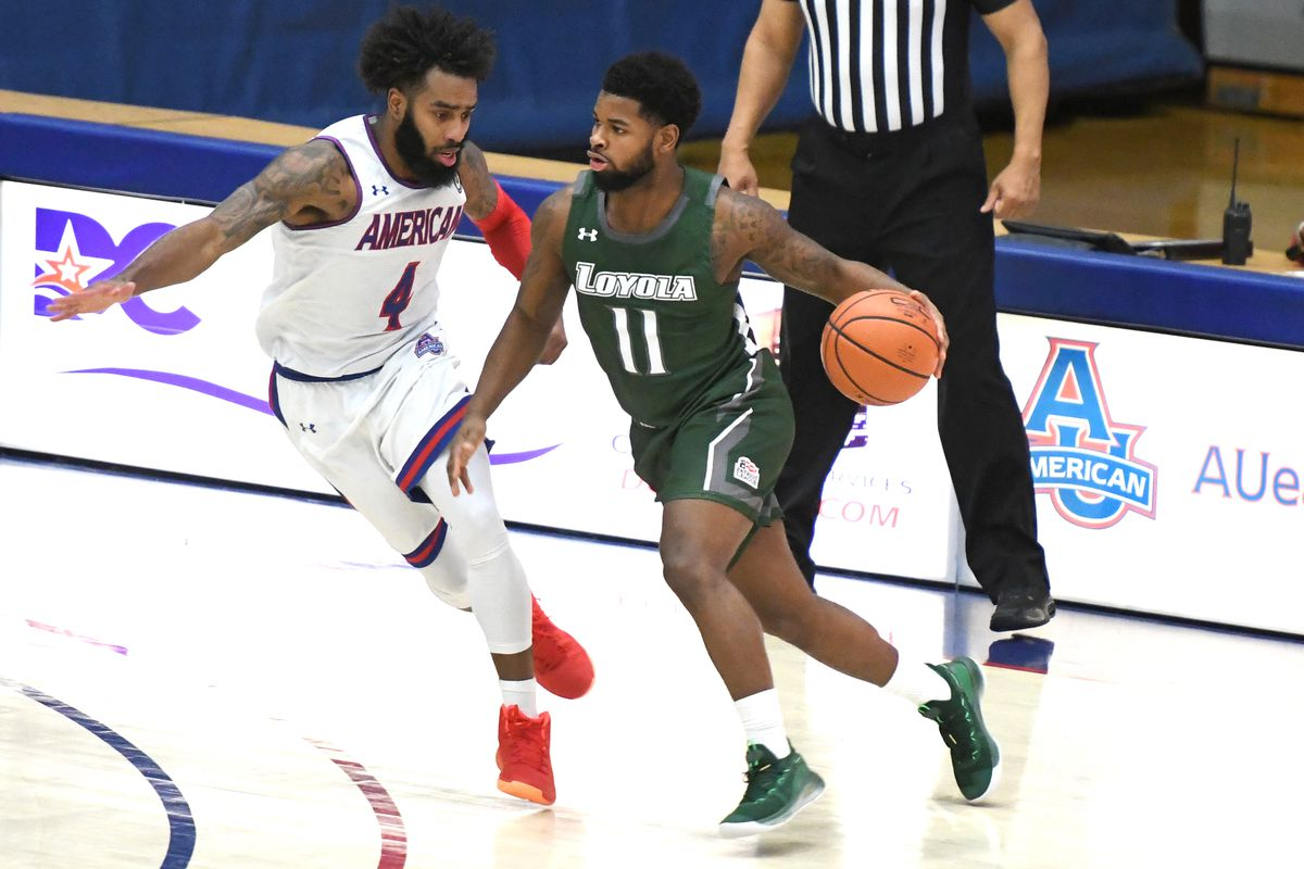 Brandon Bradsher #11 of the Loyola (Md) Greyhounds dribbles the ball by Jamir Harris #4 got the American Eagles during a college basketball game against the American Eagles on January 23, 2021 at Bender Arena in Washington, DC.