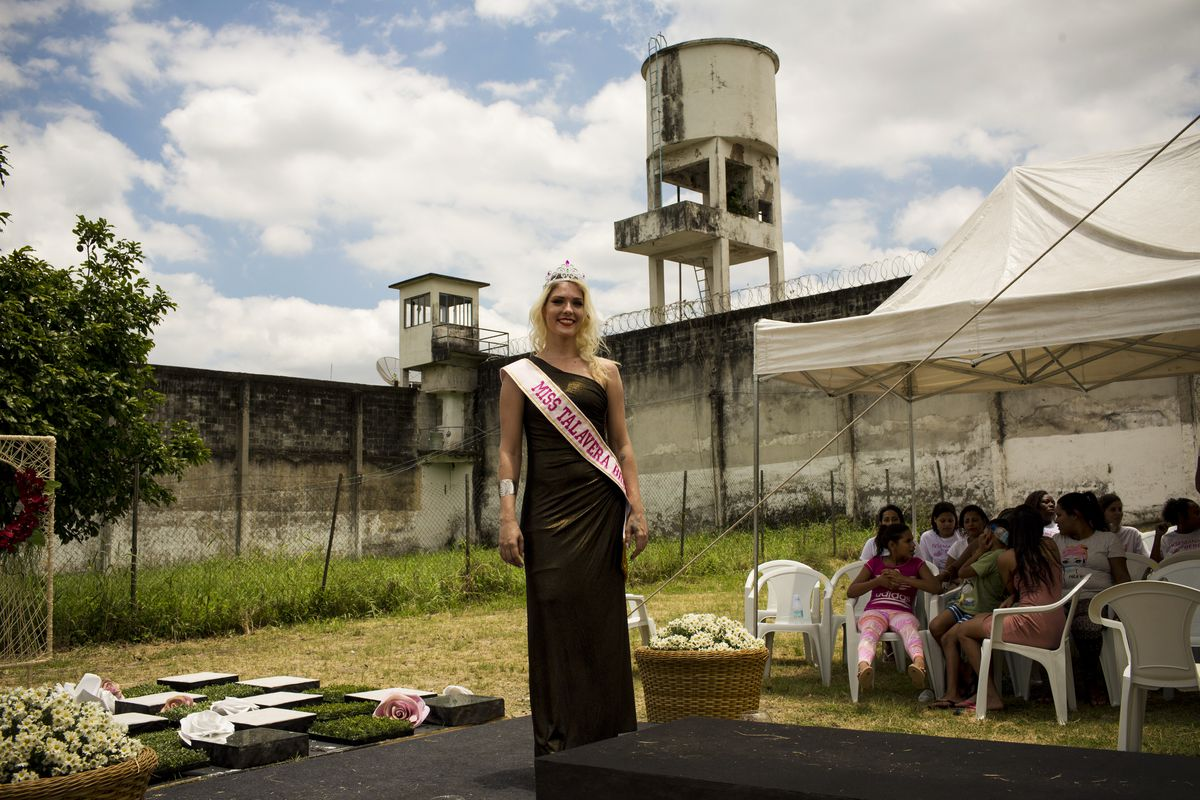 December 4: Inmate Veronica Verone, 25, poses for a photo after winning the annual beauty contest at the Talavera Bruce penitentiary in Rio de Janeiro, Brazil. Jail authorities say they organize the contests to encourage self-esteem, fight idleness and pr