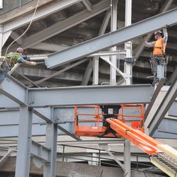 Girder being maneuvered into the right-center field patio -