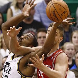 Utah Jazz's small forward Mike Harris (33) battles with Houston's Chandler Parsons for a lose ball as the Jazz and the Rockets play Saturday, Nov. 2, 2013 in EnergySolutions arena. Jazz lost 104-93.