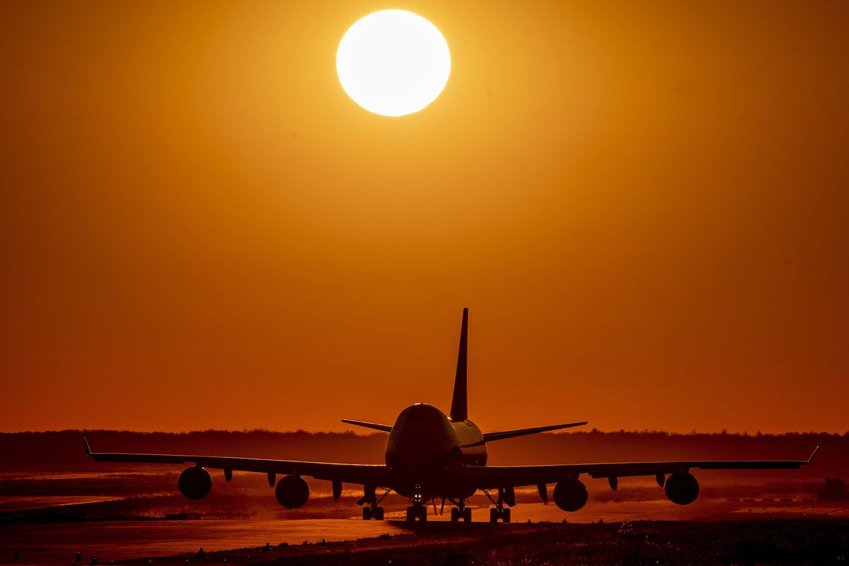 A Boeing 747 rolls to the tarmac at the airport in Frankfurt, Germany, as the sun rises on Friday, Aug. 7, 2020. Due to the coronavirus many airlines suffer from financial losses.