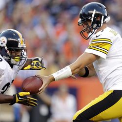 Pittsburgh Steelers quarterback Ben Roethlisberger (7) hands off to running back Isaac Redman (33) during the first quarter of an NFL football game against the Denver Broncos, Sunday, Sept. 9, 2012, in Denver.