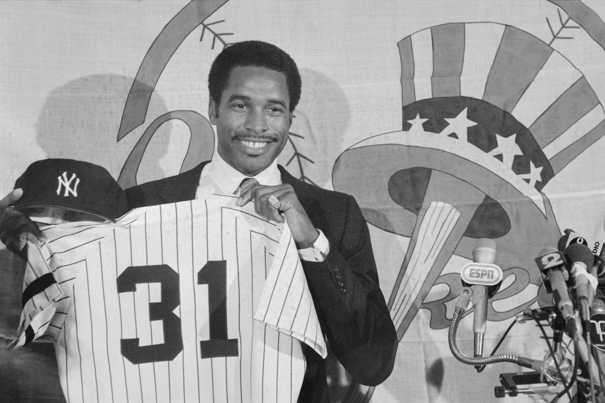 Dave Winfield Holding Shirt and Cap