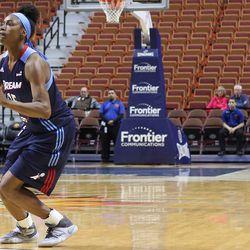 Atlanta Dream's Tiffany Hayes shoots a three-pointer.