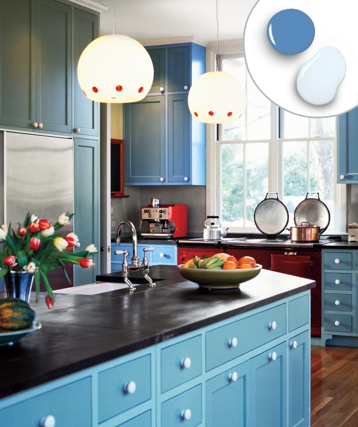Painted blue kitchen cabinet and drawers paired with black countertop.