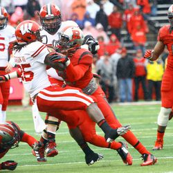 Badger running back Melvin Gordon is upended by Rutgers defender Lorenzo Waters.