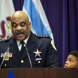 His 10-year-old son watches as Chicago Police Department Supt. Eddie Johnson announces his retirement during a press conference at CPD headquarters, Thursday morning, Nov. 7, 2019.