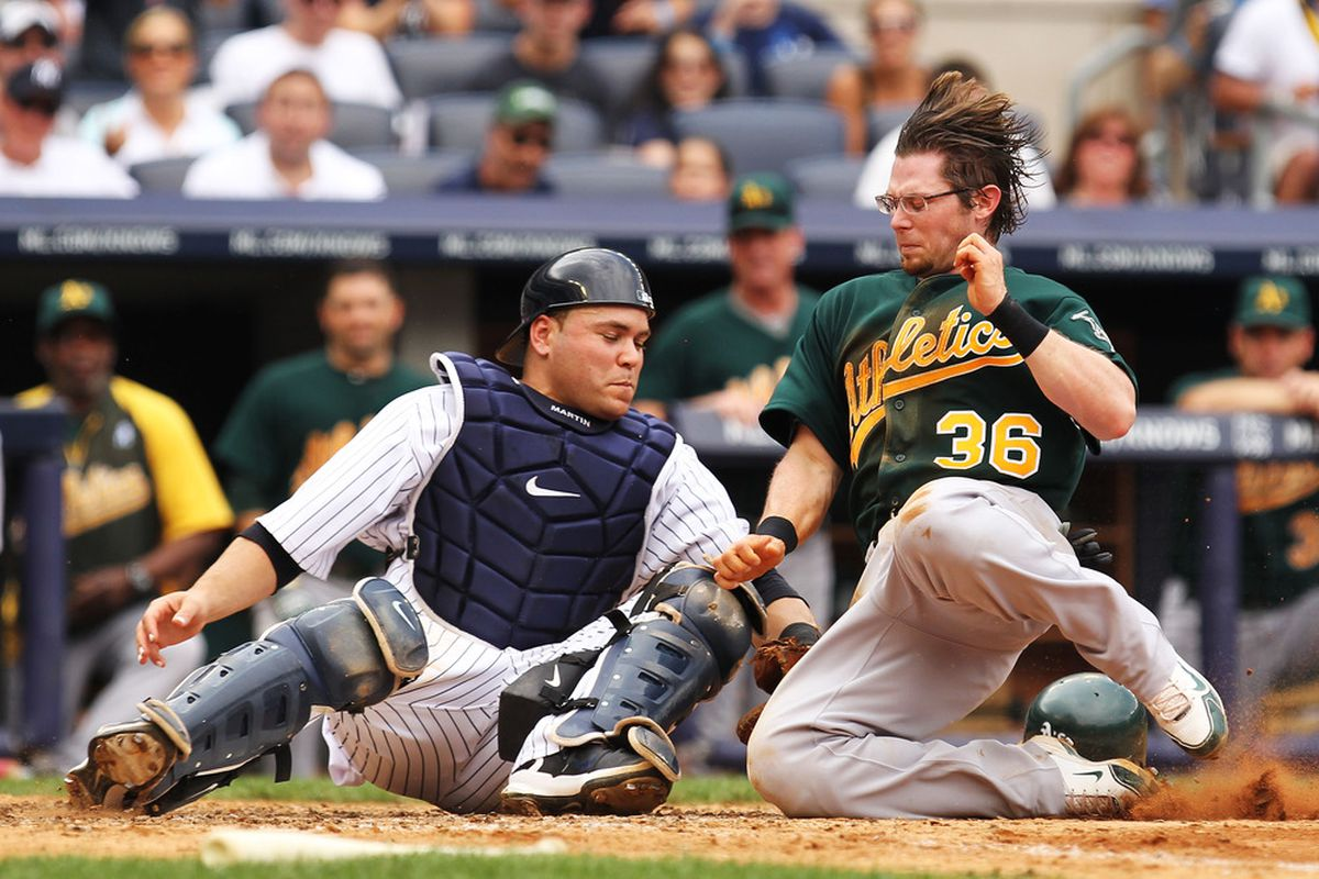This is a man in glasses in a play at the plate