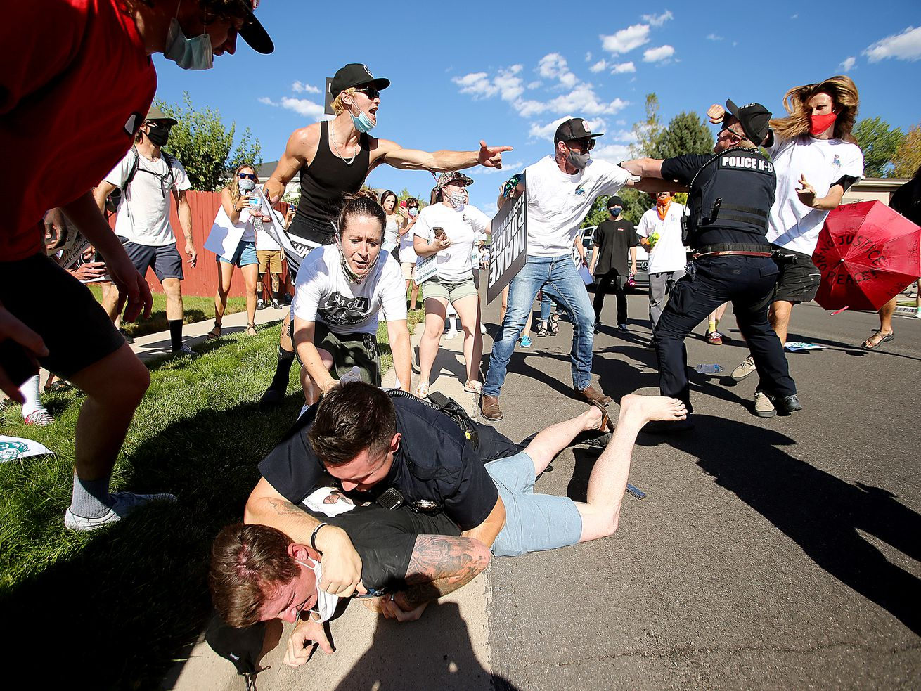 Protesters arrested in clash with Cottonwood Heights police