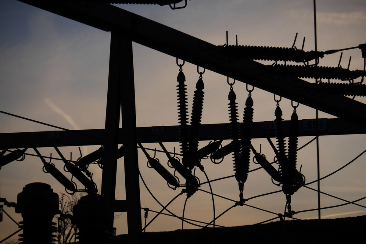 Electrical equipment and wires in silhouette.