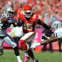 Kansas City Chiefs defensive back Quintin Demps (35) returns an interception between Oakland Raiders wide receiver Rod Streater (80) and tight end Mychal Rivera (81) during the second half at Arrowhead Stadium. The Chiefs won 24-7.