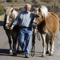 Elder Marlin K. Jensen walks with his horses, Peaches and Cream, in Huntsville, Thursday, Sept. 27, 2012.