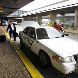 Taxis are seen Tuesday, Oct. 25, 2011, at the Salt Lake City International Airport. The airport has awarded a new cab concessionaire contract to Ace Taxi Service and Total Transit.