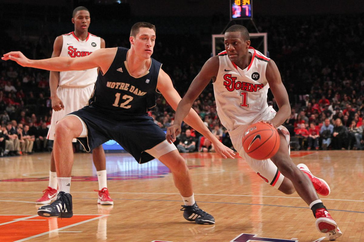 Feb 25, 2012; New York, NY, USA; St. John's Red Storm guard Phil Greene (1) drives past Notre Dame Fighting Irish guard Alex Dragicevich (12) during the second half at Madison Square Garden. St John's won 61-58. Anthony Gruppuso-US PRESSWIRE