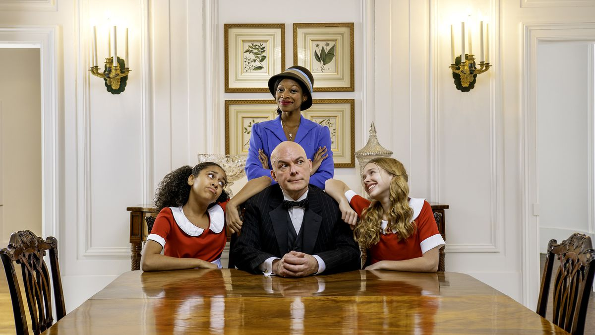 """Citadel Theatre's production of """"Annie"""" includes  Kayla Norris (at the table, from left), John B. Boss, and Sophie Kaegi, and Chamaya Moody (standing). Norris and Kaegi will be alternating the title role."""