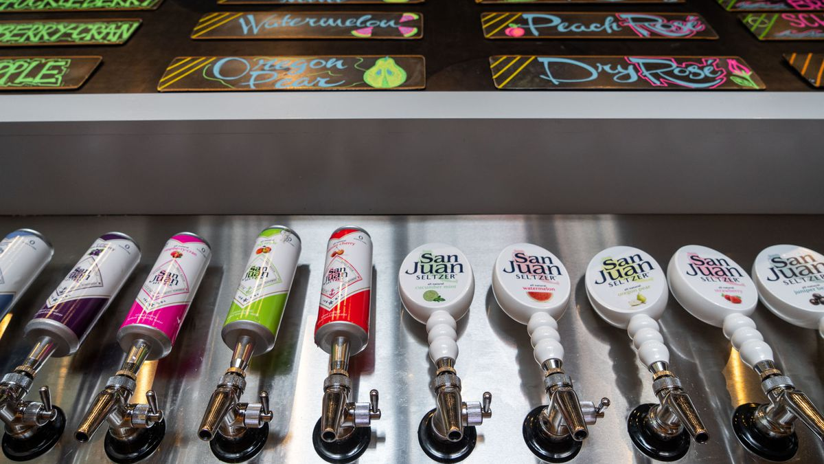 Looking up from the San Juan Seltzery's hard seltzer taps to the colorful menu.