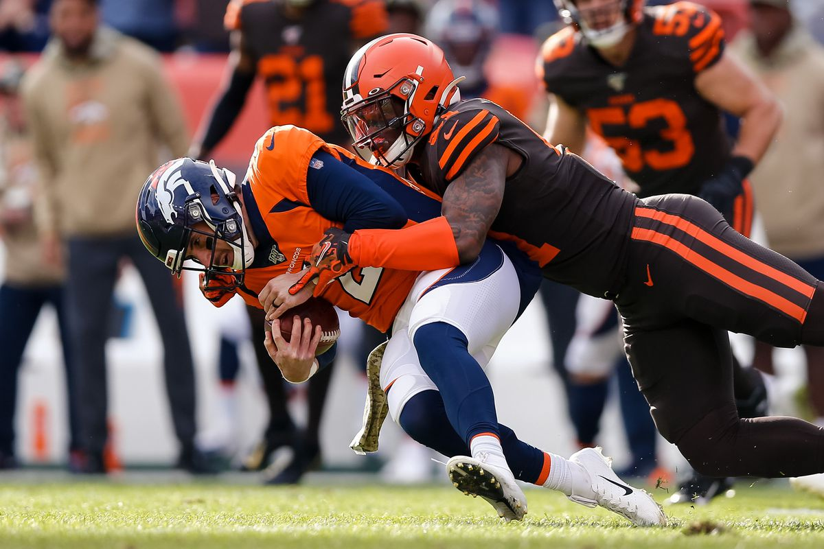 Denver Broncos quarterback Brandon Allen is sacked by Cleveland Browns linebacker Mack Wilson in the first quarter at Empower Field at Mile High.